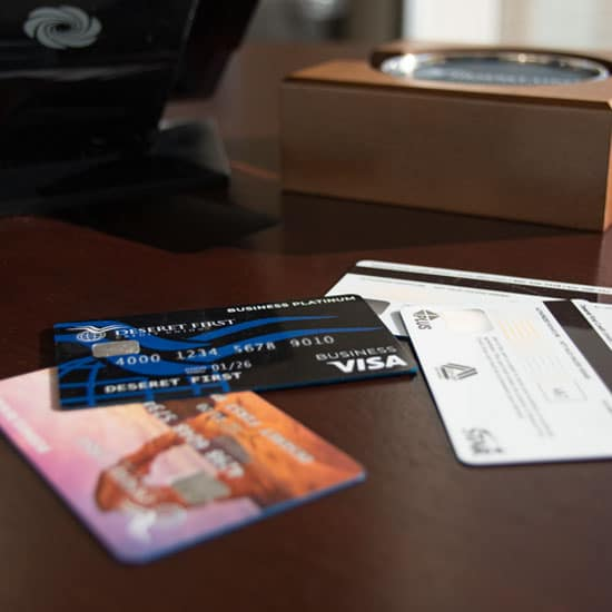 close up of a set of business credit cards laid out on a desk