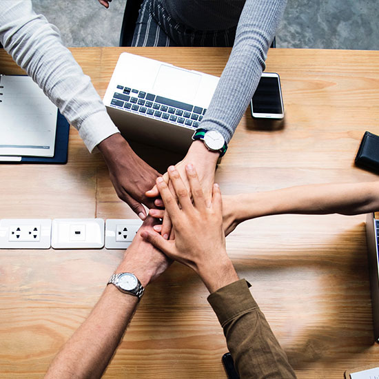 business team putting their hands together, teamwork