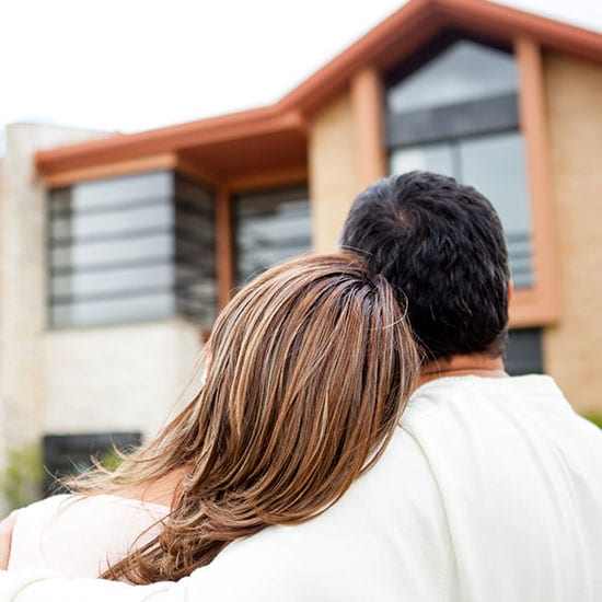 couple looking at home exterior