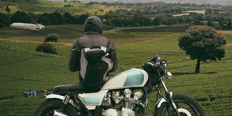rider enjoying the landscape with their motorcycle