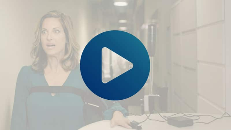 screengrab of CUNA advocacy video with a play icon overlay; anxious woman in polygraph test