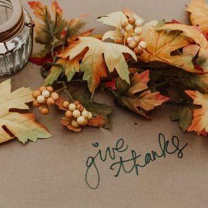 autumn leaves and berries decor, with the writing 'give thanks'