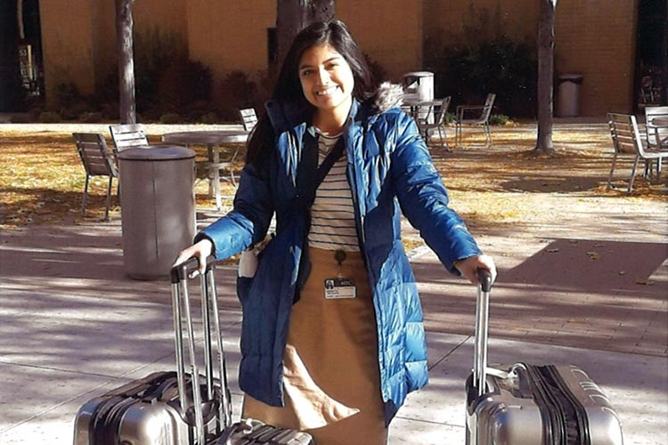 sister missionary standing with her luggage