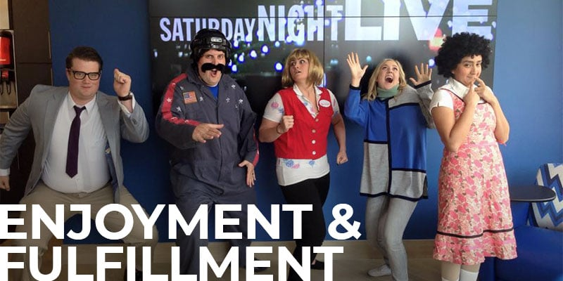 group of DFCU employees dressed up for Halloween, with the text overlay: Enjoyment & Fulfillment