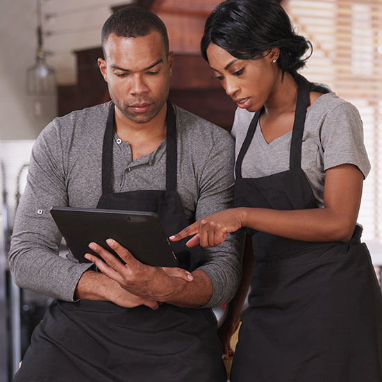 bakery business partners looking at a tablet together