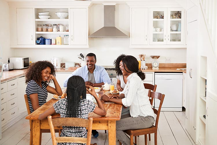 family enjoying their dinner together at home