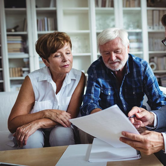 mature couple discussing options with a financial advisor