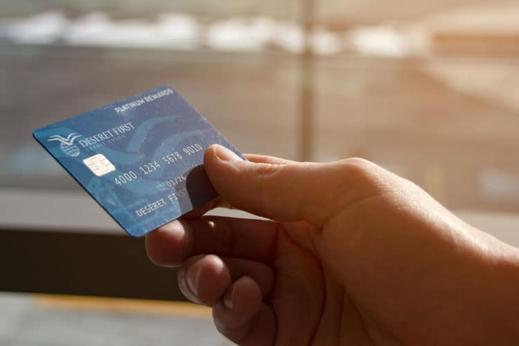 close up of a hand holding a credit card, shallow depth of focus