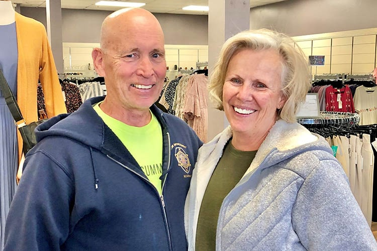 senior missionary couple smiling after their donation
